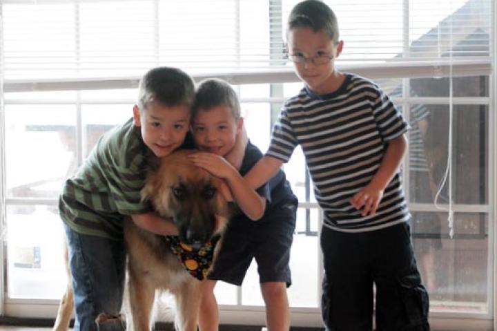 Collin, Joel and Aaden couldn't be happier to share their 7th birthday with their dog, Shoka.