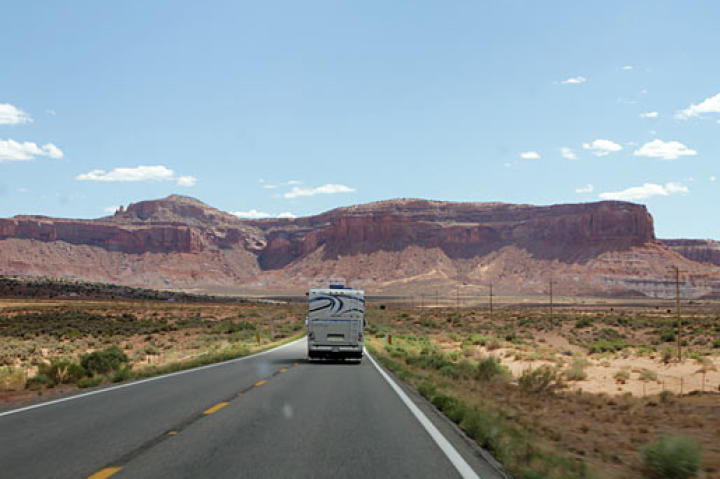 "The families' replacement RV, the ""New Party Bus"" on the road in Utah."