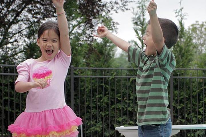Hannah and Joel jump for joy over the official opening of the Gosselin family pool.