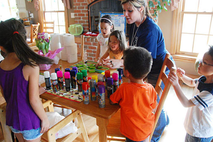 The Gosselin's babysitter, Ashley, instructs the kids on the fun activities of the day.