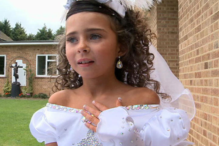 Decked out in bling from head to toe, this little girl is ready for her first holy communion.