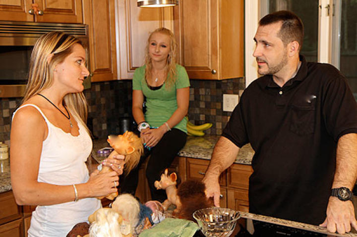 Michelle and her family are discussing where to put her newly purchased troll dolls.