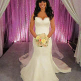 Milagros achieved bridal perfection in this $2,422 Augusta Jones gown.