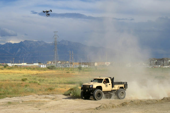 The aerial drone follows alongside the completed Duramax Diesel truck.