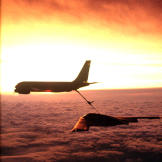 With a beautiful backdrop a KC-135 Stratotanker from McConnell Air Force Base, Kansas, refuels a B-2 Spirit Bomber.