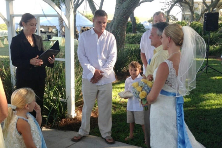 Ansley walks down the aisle in her Something New wedding dress,