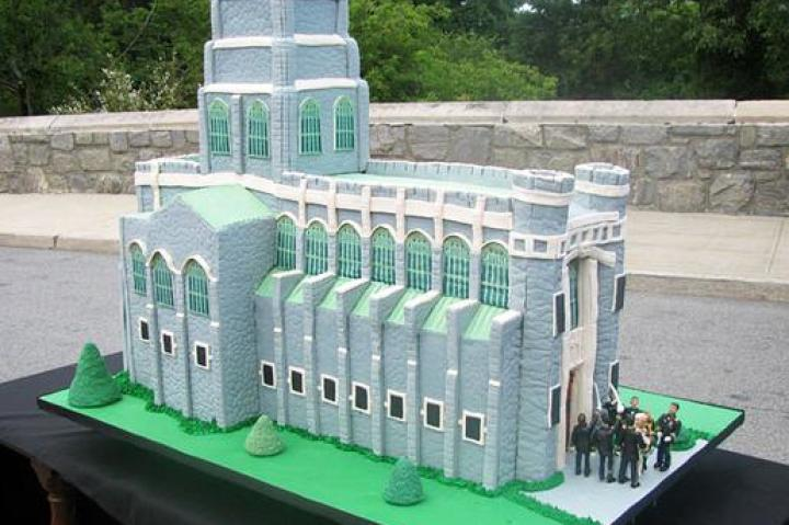 "WEST POINT CAKE   How was the cake made?  The cake was made of chocolate cake, chocolate fudge, vanilla buttercream, Rice Krispies Treats (chapel walls), gray fondant (cobblestone walls), fondant and edible ink (DecoPac printed stained glass windows), green buttercream (grass), and modeling chocolate (sculpted soldiers, couple getting married).  What's memorable about the cake?  When making cakes that resemble buildings and delivering that cake to that building, it's imperative the cake resembles the building to a tee. Remy had a hard time getting the roofline just right but luckily Buddy noticed it didn't match the photos of the chapel. They were able to fix it before the cake went out the door...whew!  Click ""Next"" to see the next sketch."