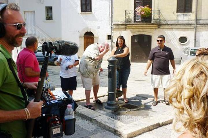Mauro and the family take a minute to cool down at a drinking fountain in Altamura.