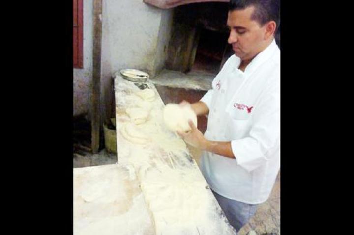 Buddy kneads bread dough in Altamura.