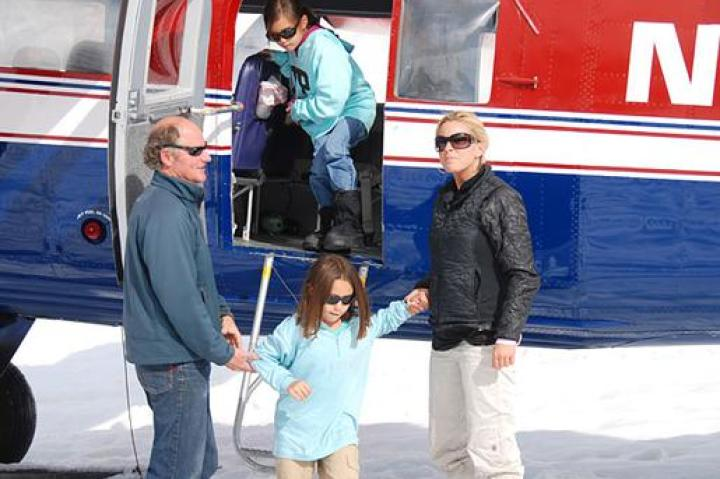 Kate Gosselin and children getting out of the plane onto the glacier.