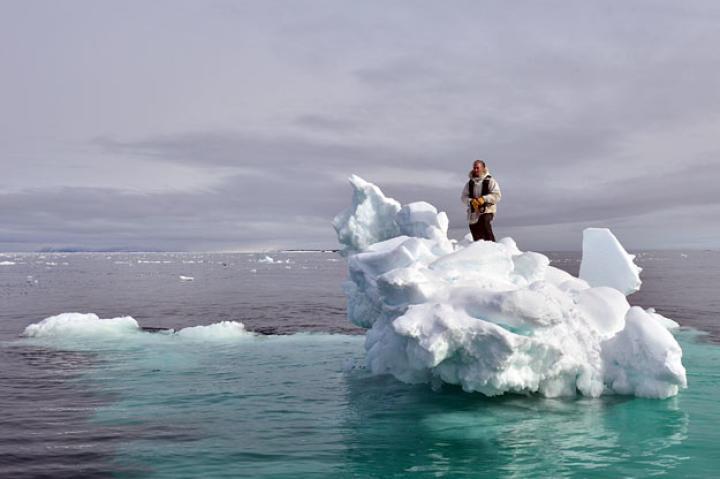 Gordon Buchanan standing on an iceberg looking for Lyr