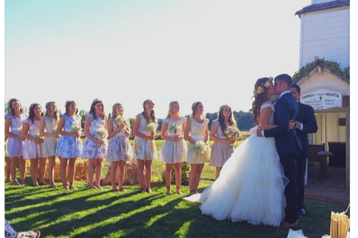 A lovely shot of the couple's first kiss as husband and wife. Watch this