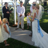 """Ansley walks down the aisle in her Something New wedding dress, """"Lace"""