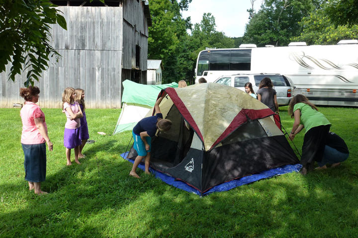 The Duggar and Bates ladies test out the tents for their camping tip.
