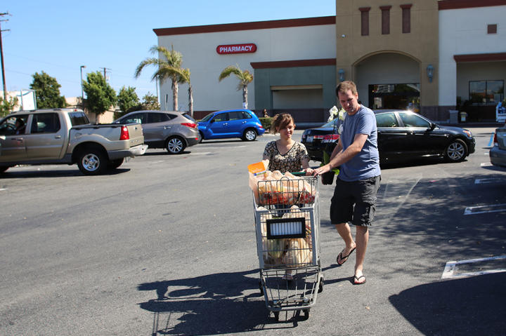 Kirlyam pushes the grocery cart as Alan helps guide it. It seems like an everyday task, but it's new to her!
