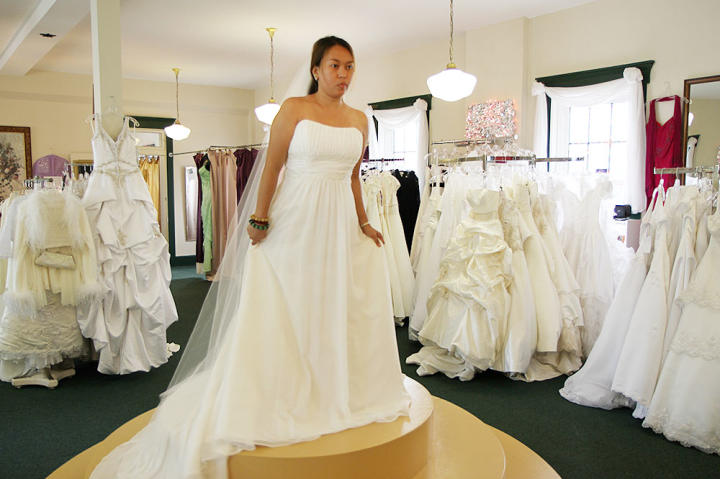Aya falls for this classic A-line wedding gown -- it's perfect, and despite her recent weight gain that's made her self-conscious, she feels absolutely beautiful.