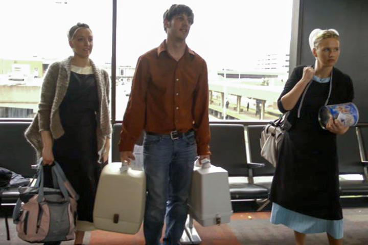 Matt is a huge help to Lizzie and Iva at the airport -- they know nothing about getting tickets and going through security. His excitement about California is dulled when his housemates rebel against the rules he writes for good behavior (the ten coMattments).