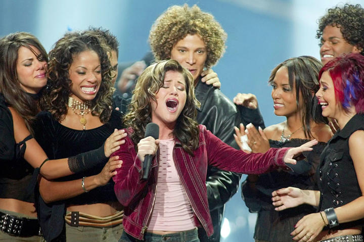 """20-year-old Kelly Clarkson sings """"A Moment Like This"""" as winner of """"American Idol"""" in 2002."""