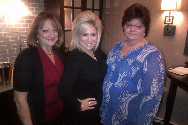 Winner Sharon Zak (right) and her lucky friend got to meet Theresa Caputo.