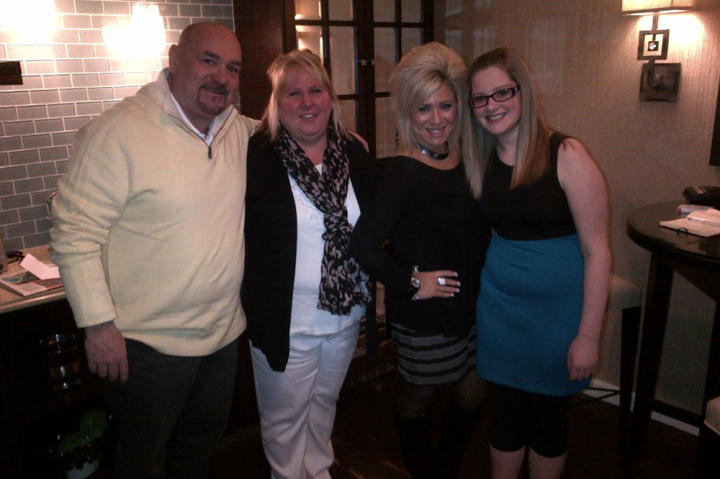 Theresa Caputo with contest winner Tina Maria and her husband and daughter.