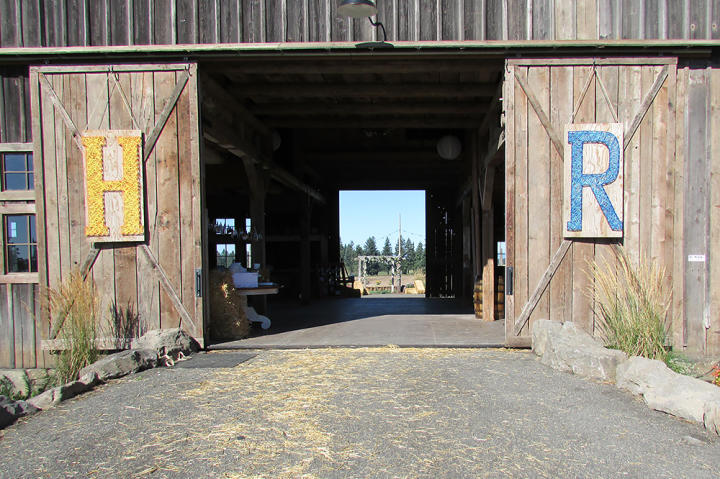 More string art representing Hannah and RJ's initials decorates the barn.