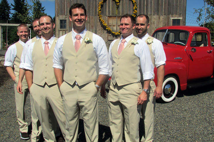 Kevin and his groomsmen wore tan pants and vests with suspenders and coral ties.