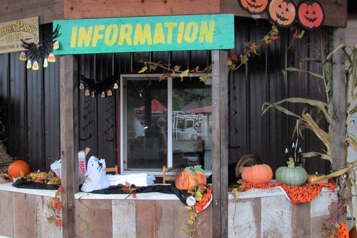 The information booth is festively decorated for Halloween and pumpkin season.