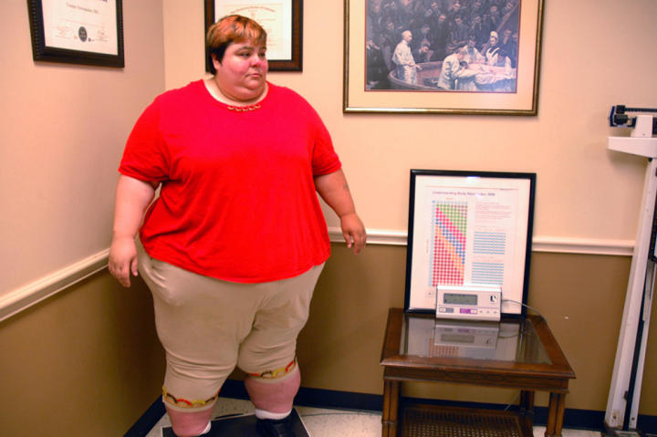 "At Dr. Now's office, Paula steps on the scale and learns what her current weight is. ""I'm huge,"" she says. ""I look like a monster."""