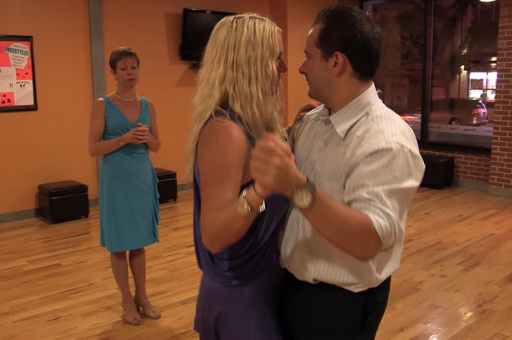 Amanda and her fiance, Joe, a quiet auditor who lives with Amanda and her parents, practice their first dance.
