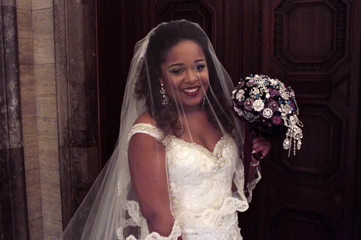 The bride beams at her royal-themed wedding.