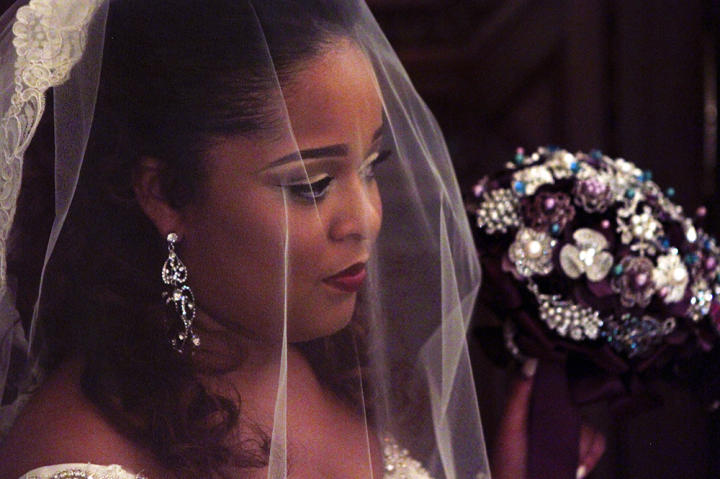Chandelier earrings, smoky eyes and a matte lip add drama to Terron's Something Borrowed look.