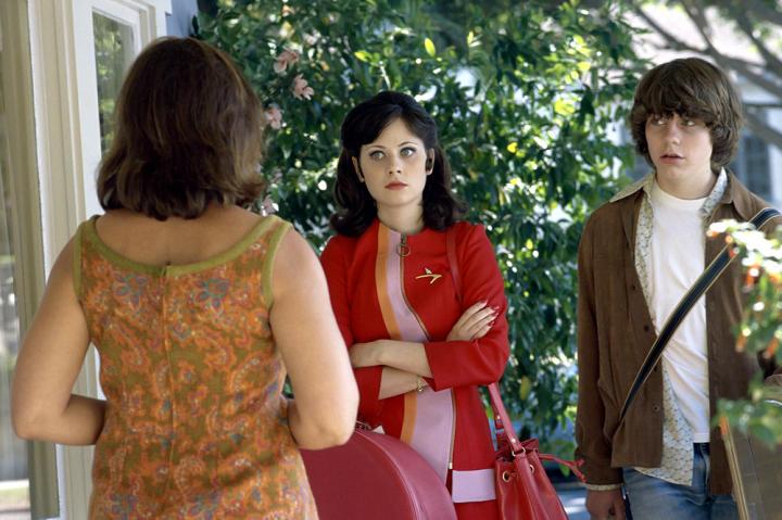 Zooey Deschanel as the flight attendant older sister in the movie