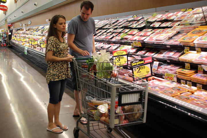Alan shows Kirlyam a supermarket so she can become accustomed to grocery shopping.
