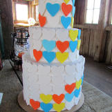 The cake echoed Hannah & RJ's color scheme of persimmon, peach, green,