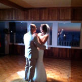 Karina dances with her groom in her Something New wedding dress.