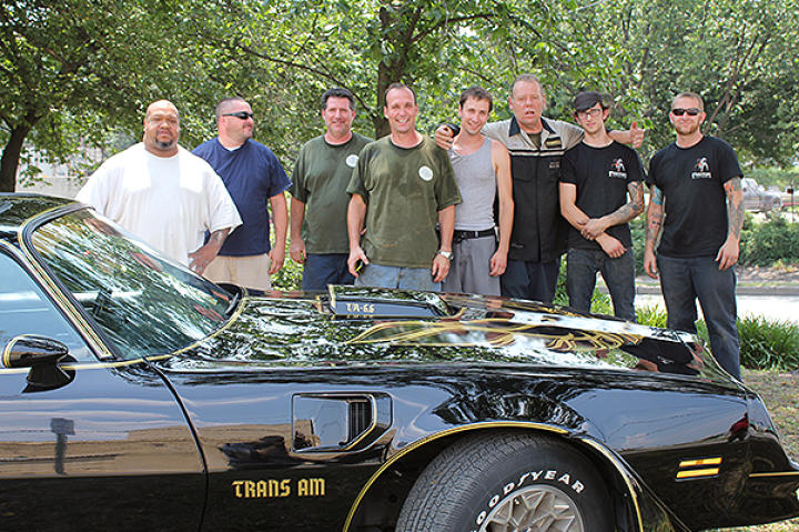 Dan and some of the crew pose with a finished Trans Am.
