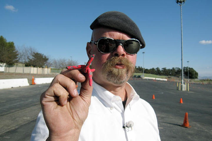 Jamie Hyneman shows off the tire spikes used to thwart a pursuing vehicle in Spy Car Escape.