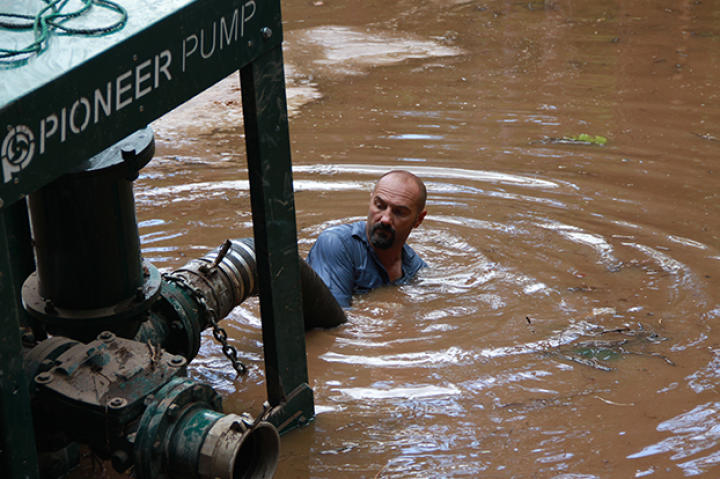 Dave Turin dives into flood waters saving their pump.