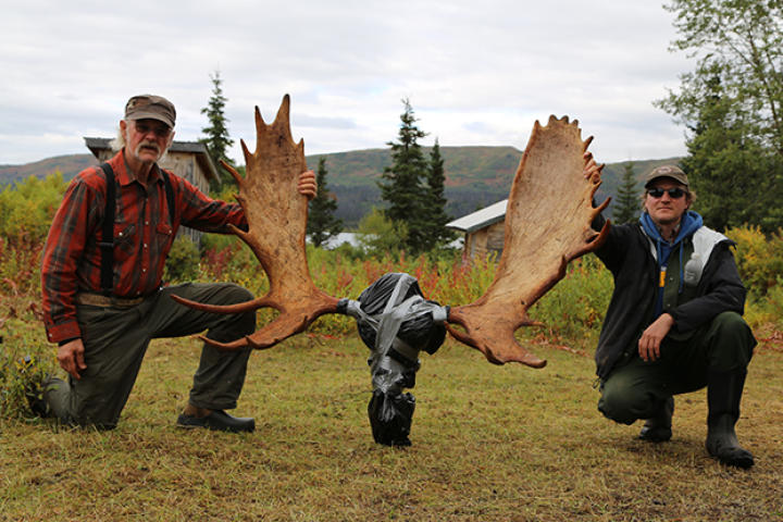 Atz Kilcher and Atz Lee Kilcher kneel aside the moose rack, which they got from their recent moose hunt near Caribou Lake.