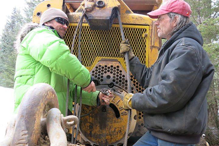 Dustin and Mike work on the aging snowplow.
