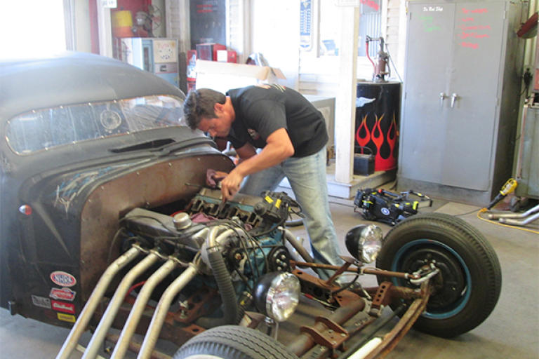 Jeff Thisted works on the engine of a Rat Rod - a style of hot rod that's meant to look a little rough around the edges, even when it's finished.
