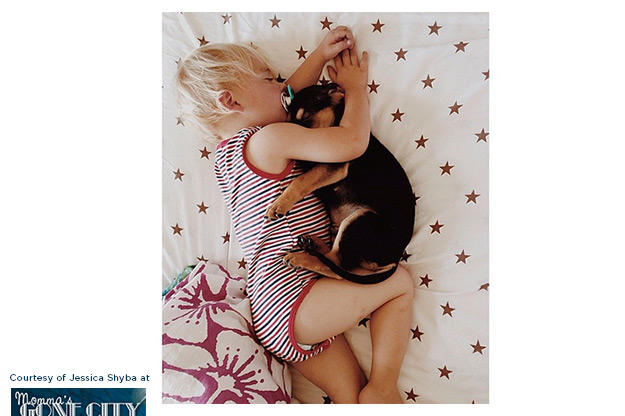 Beau's mother captured these adorable images of the two cuddling in bed.