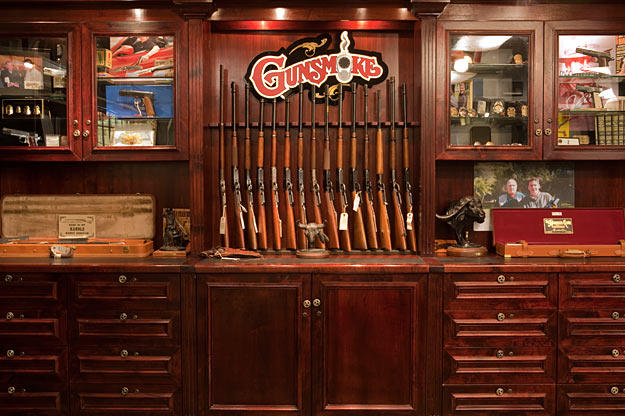 """One of the most beautiful views in the shop is this rack of Winchesters, the gun that says """"American"""" second to none."""