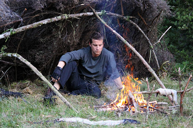 In order to keep the meat moist and prevent all the fats and the nutrients from leaching out, Bear Grylls places his eel meal away from the fire's flames.