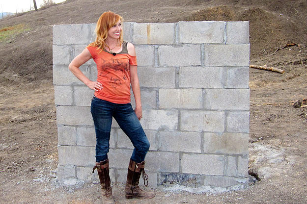 A concrete wall helps Kari Byron determine just what is truly bomb proof.