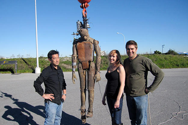 """When you're falling from a great height, will landing in water be just like landing on pavement? Buster — here with his """"friends"""" Grant Imahara, Kari Byron and Tory Belleci — is about to find out."""