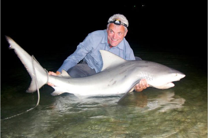 Jeremy Wade holds the catch he was really after all along: a bull shark, a species comfortable in both freshwater and saltwater, and responsible for more attacks in the United States than any other shark species.