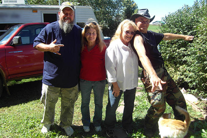 Turtleman (Ernie Brown, Jr.) and Neal James pose with cat owner Sue Craig and Patty Beery.