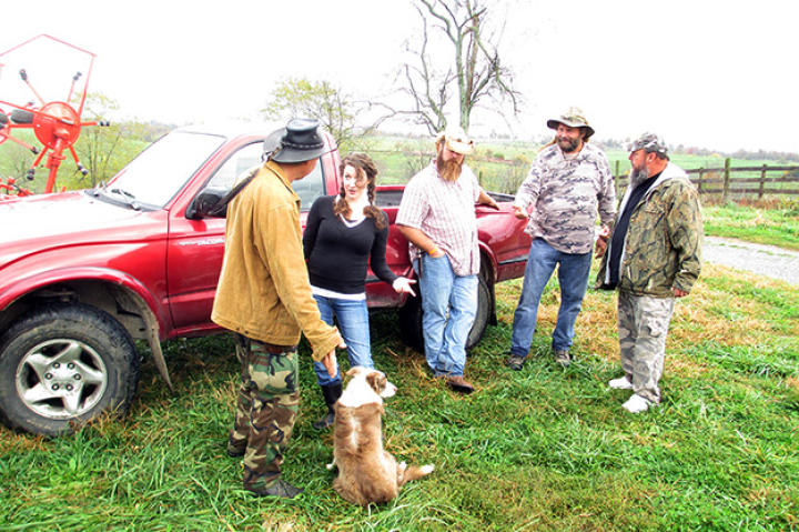 Farmer Cole Henson discusses her nuisance call with Ernie Brown, Jr., the Turtleman, and his crew.