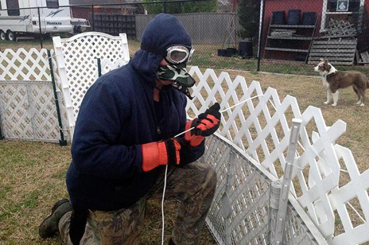 Turtleman prepares to catch the critter in homeowner Linda Jangula's backyard.
